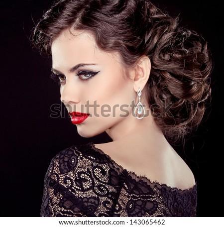 Fashion Brunette Model Portrait. Jewelry and Hairstyle. Elegant lady Isolated on black background. - stock photo