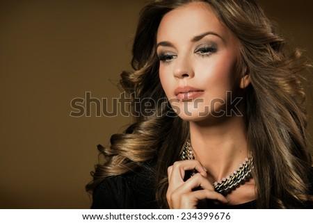 Fashion brunette portrait of beautiful woman - stock photo