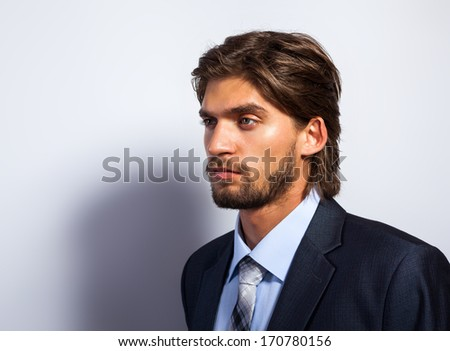 Fashion business man look side to copy space, Handsome serious male model face close up profile portrait, young businessman over gray background