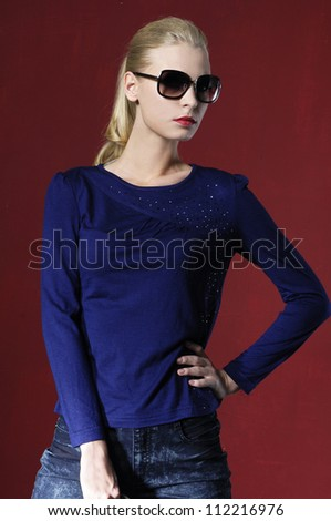 fashion casual girl with sunglasses standing posing