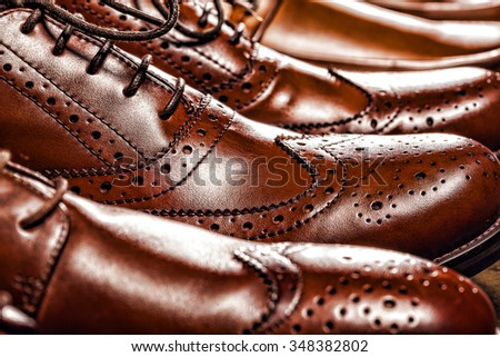 Fashion classical polished men's brown oxford brogues - stock photo