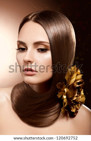 Fashion Classy Brunette . Beautiful Makeup and Healthy Brown Hair. Flower