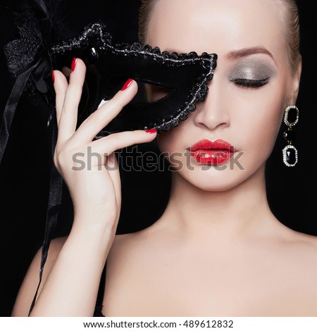 fashion close-up portrait of beautiful girl in mask.young blond woman.masquerade