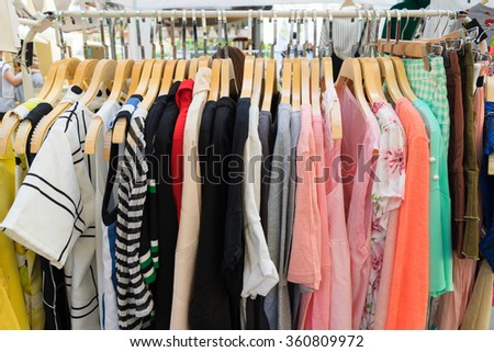 Fashion clothes for female on a clothing rack - stock photo