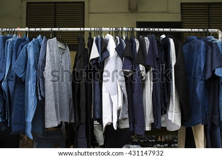 Fashion clothes hanging on hanger rack