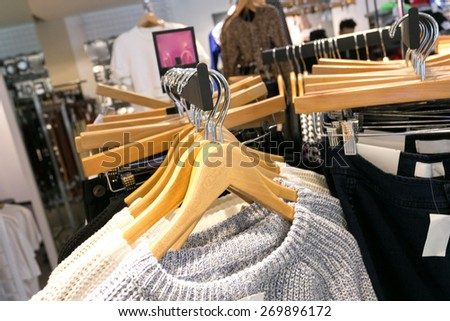 fashion clothes shop interior  - stock photo