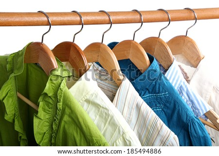 Fashion clothing on hangers at the show isolated on white background. - stock photo