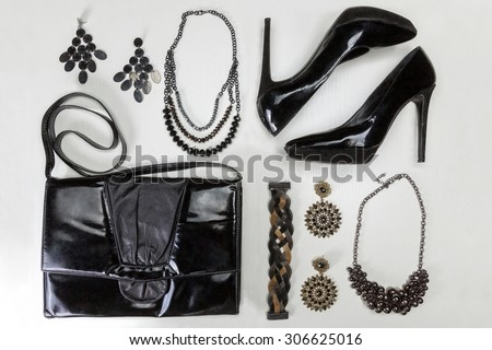Fashion concept. Black elegant woman`s accessorize, isolated on white background. Top view. - stock photo