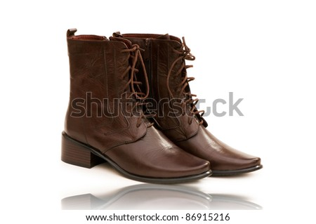 Fashion concept with boots on white - stock photo