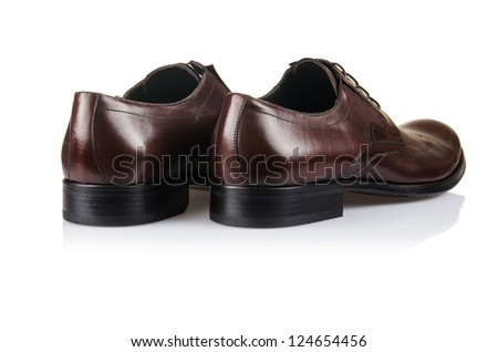 Fashion concept with male shoes on white - stock photo