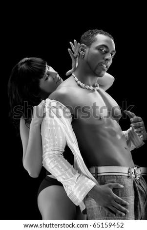 Fashion Couple Dramatic image shot in studio - stock photo