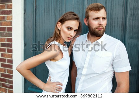 fashion couple standing in the European quarter, in a white dress, posing love at sunset. Card Valentine's Day - stock photo