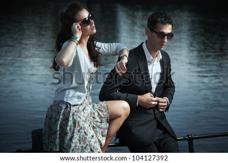 fashion couple with sunglasses - stock photo