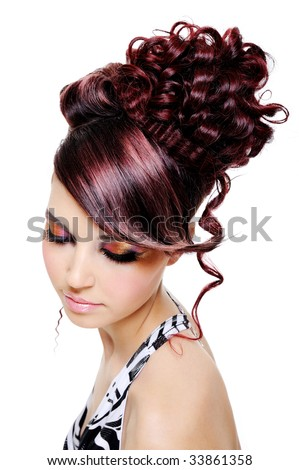 fashion creative hairstyle on the head of the young beautiful woman - stock photo