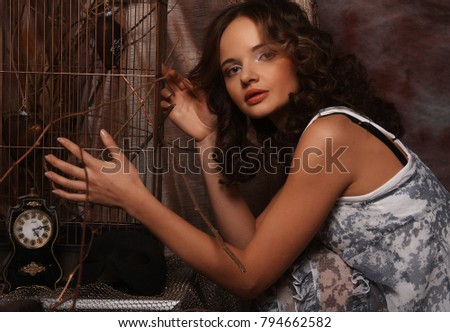 fashion curly model sitting on a stool in drama decoration