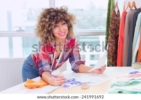 Fashion designer at work - stock photo