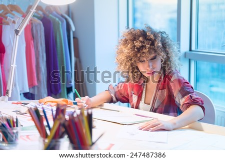 Fashion designer Designs outfit - stock photo