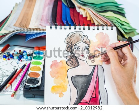 Fashion designer drawing illustration with equipment and materials - stock photo