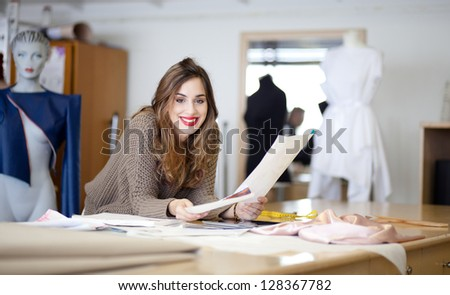 Fashion designer going through her sketches