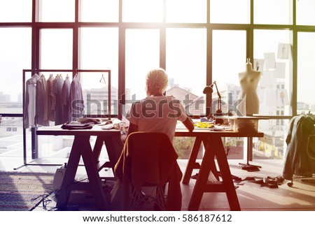 Fashion designer working on her workspace