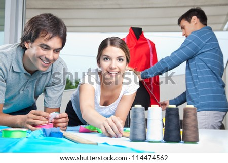 Fashion designers working together at workplace. - stock photo