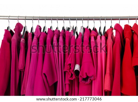 Fashion female autumn/winter red clothes rack display  - stock photo
