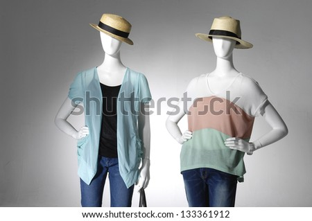 fashion female clothes in hat on two mannequin - stock photo