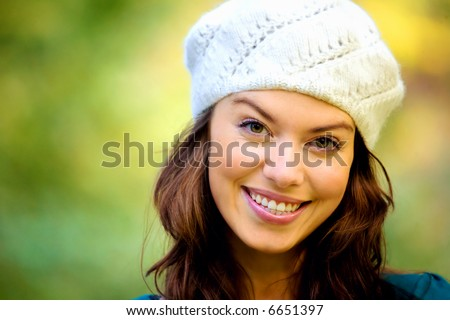 fashion friendly girl portrait outdoors smiling and wearing a hta - stock photo