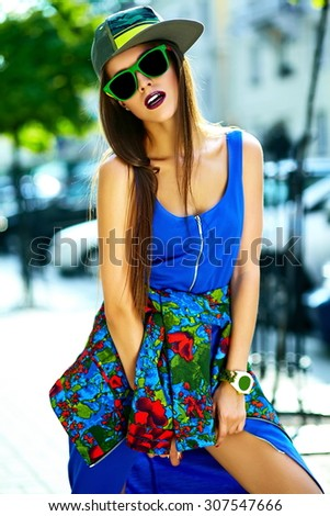 Fashion funny  glamor stylish sexy smiling  beautiful  young woman model in blue hipster summer clothes  in the street in cap - stock photo