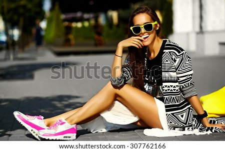 Fashion funny  glamor stylish sexy smiling  beautiful  young woman model in hipster summer clothes sitting in the street with shopping bright yellow bag - stock photo