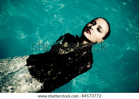 Fashion girl clothes in water - stock photo