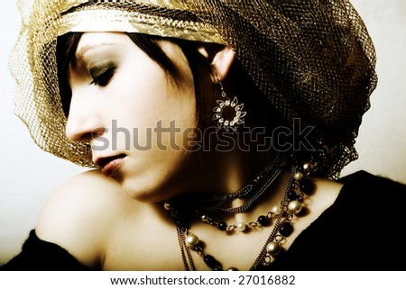 fashion girl in golden boa and  earring
