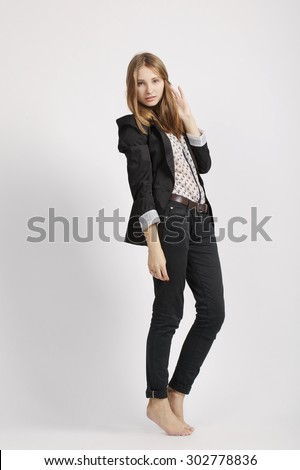 Fashion girl posing in grey background photo - stock photo