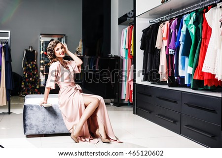 Fashion girl posing in the clothing store