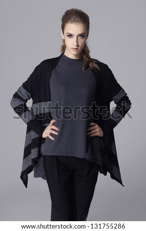 Fashion girl posing on gray background