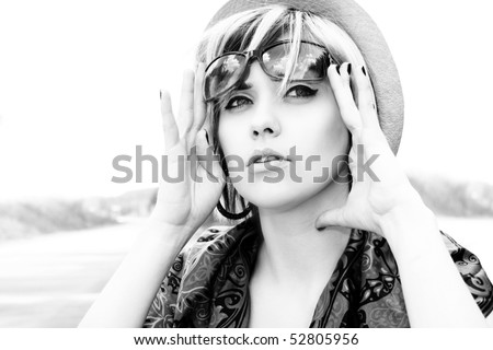 Fashion girl stops the car on road - stock photo
