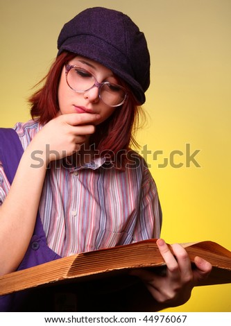 Fashion girl with old sage book