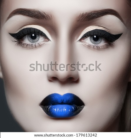 fashion gothic woman with sexy blue lips - stock photo