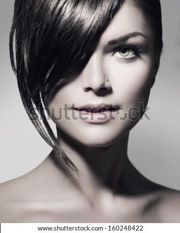 Fashion Haircut. Hairstyle. Stylish Fringe. Teenage Girl with Short Hair Style. Beauty Teenager Girl Portrait. Beautiful Black and White Portrait - stock photo