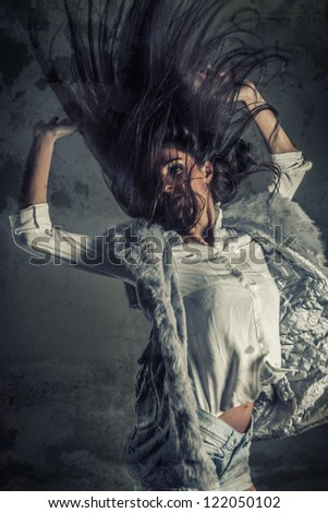 Fashion hairstyle girl with textured background and flying hair