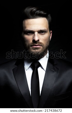 Fashion - handsome man in suit with jacket and tie - stock photo