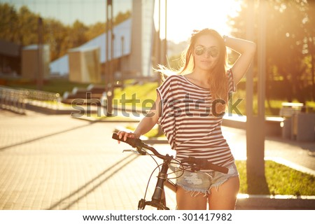 Fashion Hipster Teenager with Bicycle in the City. Toned and Filtered Photo. Modern Teenager Lifestyle Concept.