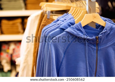 Fashion hoodie hanging in trendy boutique - stock photo
