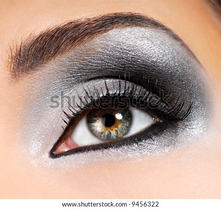 Fashion Image of woman eye with ceremonial make-up - stock photo