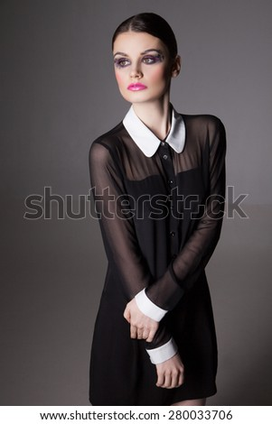 Fashion Image young woman in a stylish transparent  black dress with collar. Close-up. - stock photo