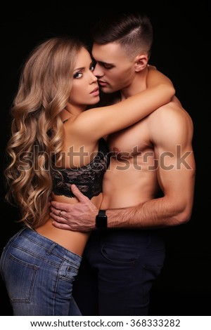 fashion interior photo of beautiful impassioned couple,wears jeans