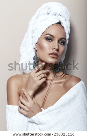 fashion interior photo of beautiful sensual woman with towels on her head and body, with bijou - stock photo