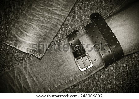 Fashion jeans, a leather belt with a buckle. Black and white photo in retro style - stock photo