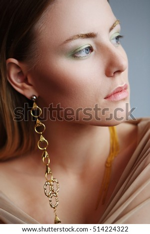 Fashion, jewelry. Lovely woman with beautiful earrings