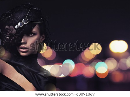 Fashion lady over city background - stock photo